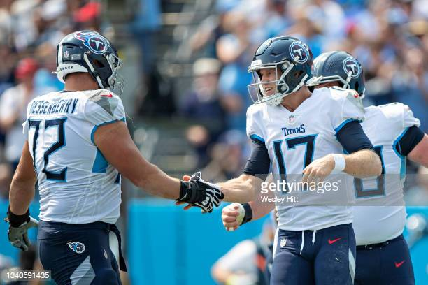 Ryan Tannehill is congratulated by David Quessenberry of the Tennessee Titans during the game against the Arizona Cardinals at Nissan Stadium on...