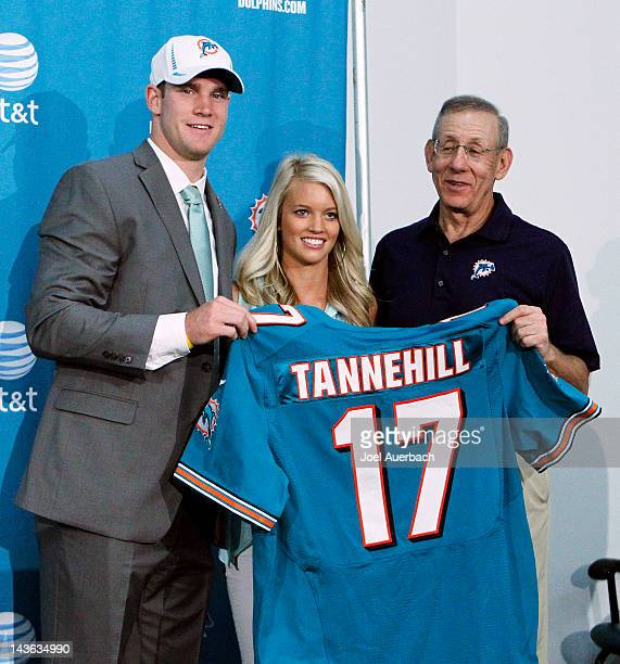 Ryan Tannehill Lauren Tannehill and Chairman of the Board/Managing General Partner Stephen M Ross hold Ryan's new Dolphins jersey after he was...