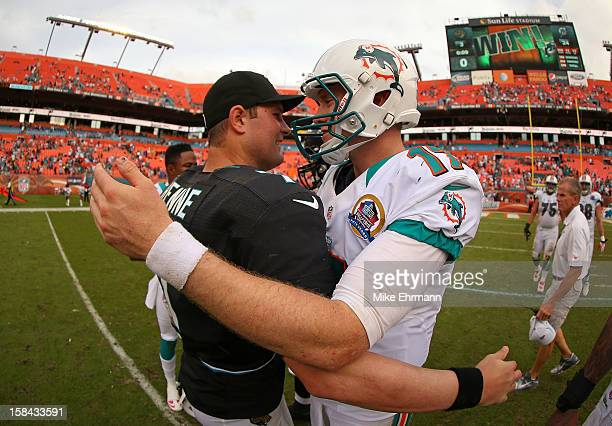 Ryan Tannehill of the Miami Dolphins and Chad Henne of the Jacksonville Jaguars shake hands after a game at Sun Life Stadium on December 16 2012 in...