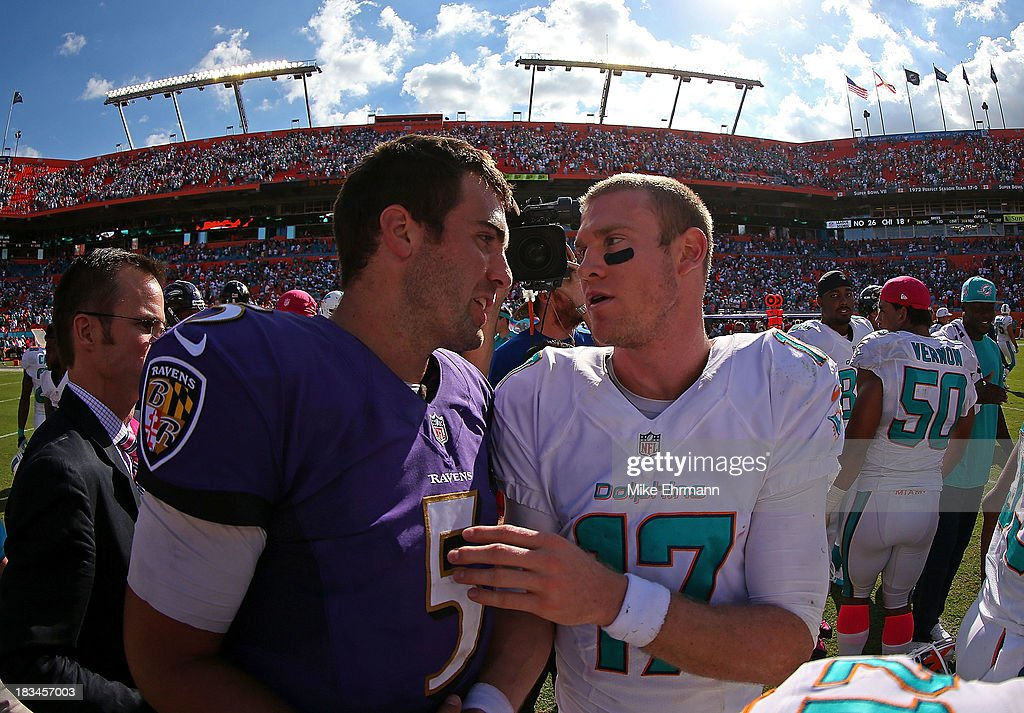 Ryan Tannehill #17 of the Miami Dolphins and Joe Flacco #5 of the Baltimore Ravens shake hands after a game at Sun Life Stadium on October 6, 2013 in Miami Gardens, Florida.