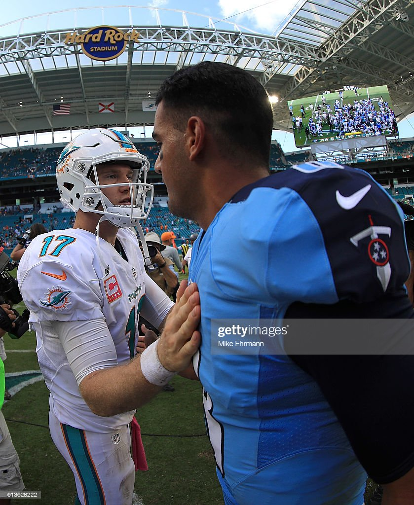 Ryan Tannehill #17 of the Miami Dolphins and Marcus Mariota #8 of the Tennessee Titans shake hands during a game on October 9, 2016 in Miami Gardens, Florida.