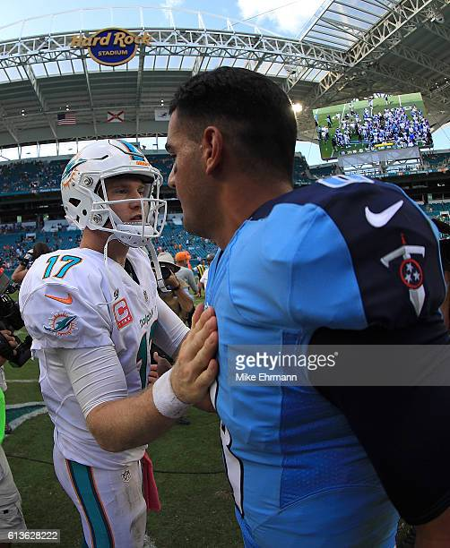 Ryan Tannehill of the Miami Dolphins and Marcus Mariota of the Tennessee Titans shake hands during a game on October 9 2016 in Miami Gardens Florida