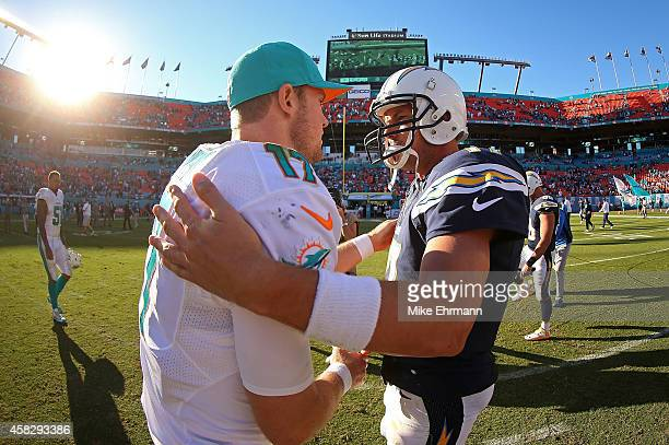 Ryan Tannehill of the Miami Dolphins and Philip Rivers of the San Diego Chargers shake hands following a game at Sun Life Stadium on November 2 2014...