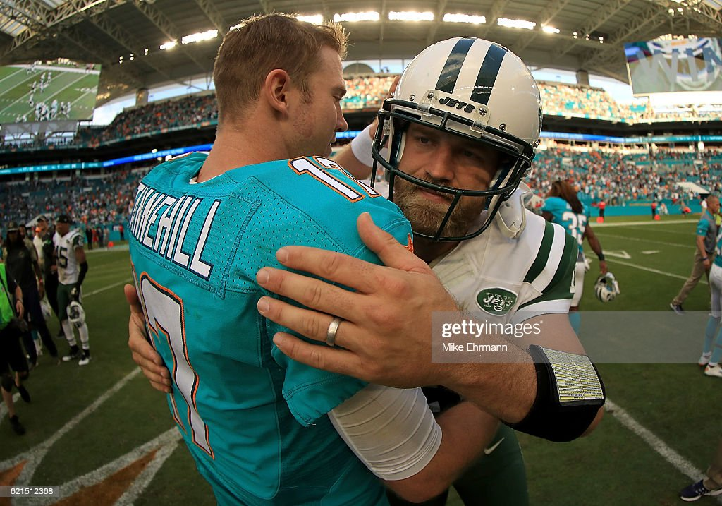 Ryan Tannehill #17 of the Miami Dolphins and Ryan Fitzpatrick #14 of the New York Jets shake hands during a game at Hard Rock Stadium on November 6, 2016 in Miami Gardens, Florida.