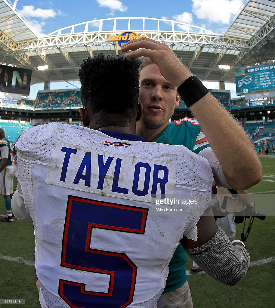 Ryan Tannehill #17 of the Miami Dolphins and Tyrod Taylor #5 of the Buffalo Bills shake hands during a game at Hard Rock Stadium on October 23, 2016 in Miami Gardens, Florida.