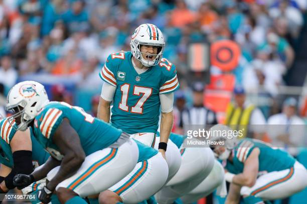 Ryan Tannehill of the Miami Dolphins calls a play at the line of scrimmage against the Jacksonville Jaguars at Hard Rock Stadium on December 23 2018...