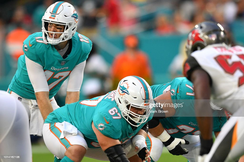 Ryan Tannehill #17 of the Miami Dolphins calls out the signals in the first quarter during a preseason game against the Tampa Bay Buccaneers at Hard Rock Stadium on August 9, 2018 in Miami, Florida.