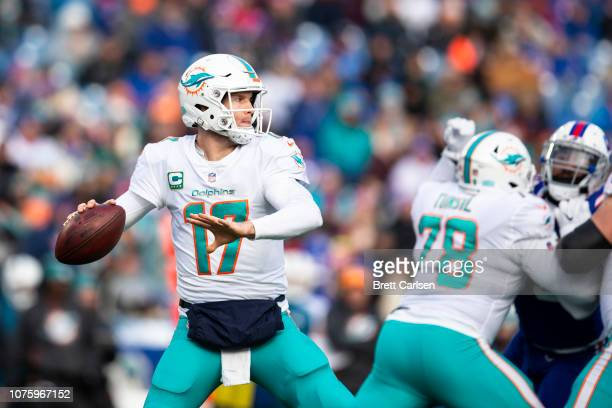 Ryan Tannehill of the Miami Dolphins drops back to pass during the third quarter against the Buffalo Bills at New Era Field on December 30 2018 in...