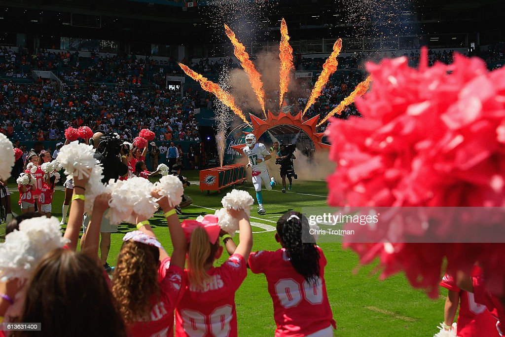Ryan Tannehill #17 of the Miami Dolphins enters the field during player introductions prior to a game against the Tennessee Titans at Hard Rock Stadium on October 9, 2016 in Miami Gardens, Florida.