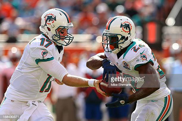Ryan Tannehill of the Miami Dolphins hands off to Reggie Bush during a game against the Jacksonville Jaguars at Sun Life Stadium on December 16 2012...