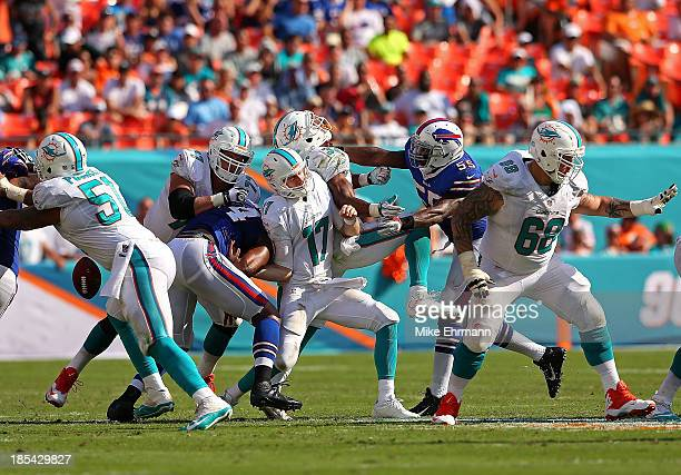 Ryan Tannehill of the Miami Dolphins has the ball knocked out by Stephon Gilmore of the Buffalo Bills during a game at Sun Life Stadium on October 20...