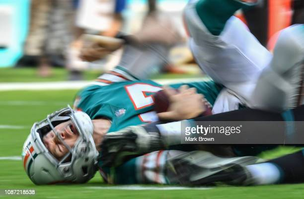 Ryan Tannehill of the Miami Dolphins in action against the Jacksonville Jaguars at Hard Rock Stadium on December 23 2018 in Miami Florida