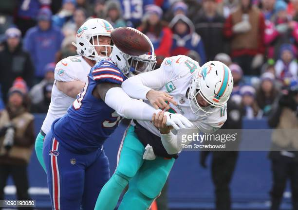 Ryan Tannehill of the Miami Dolphins is hit by Shaq Lawson of the Buffalo Bills and fumbles the football causing a turnover in the third quarter...