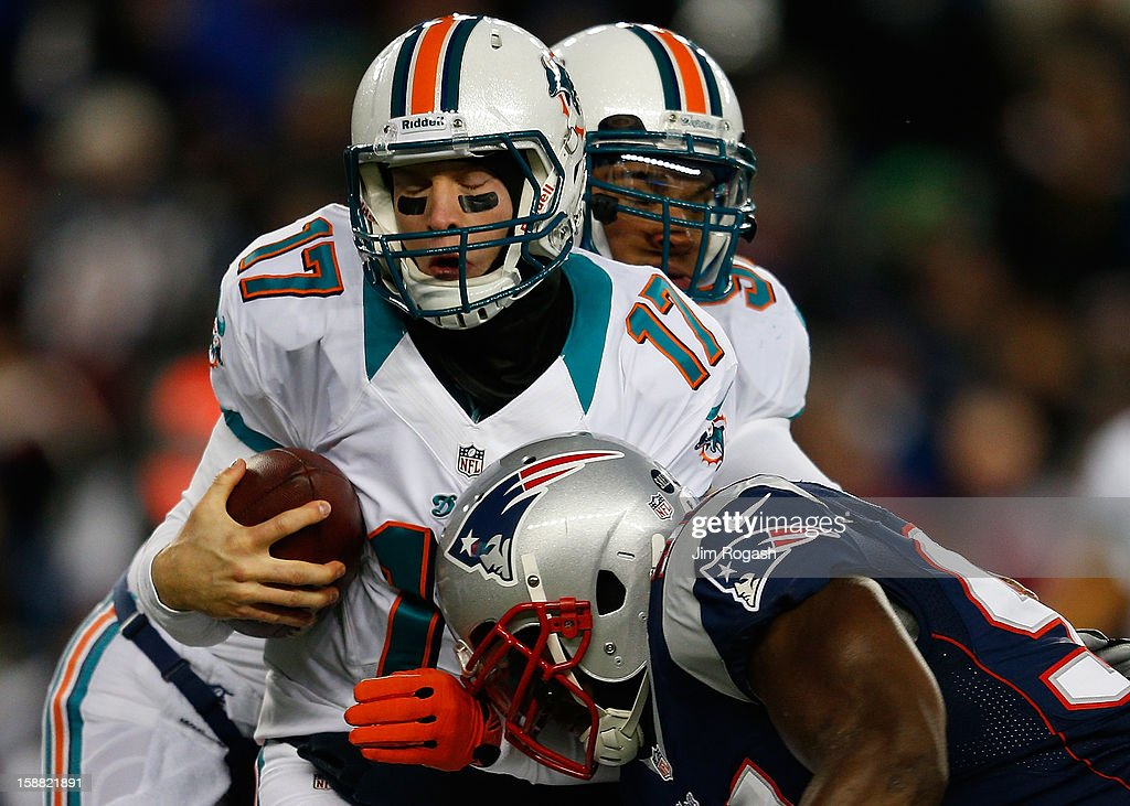 Ryan Tannehill #17 of the Miami Dolphins is sacked by Justin Francis #94 of the New England Patriots in the first quarter at Gillette Stadium on December 30, 2012 in Foxboro, Massachusetts.