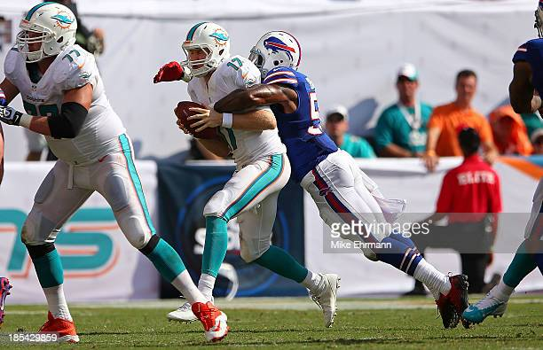 Ryan Tannehill of the Miami Dolphins is sacked by Kiko Alonso of the Buffalo Bills during a game at Sun Life Stadium on October 20, 2013 in Miami...