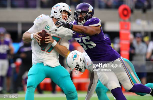 Ryan Tannehill of the Miami Dolphins is sacked with the ball by Anthony Barr of the Minnesota Vikings in the third quarter of the game at U.S. Bank...