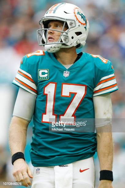 Ryan Tannehill of the Miami Dolphins looks on during the second half against the New England Patriots at Hard Rock Stadium on December 9 2018 in...