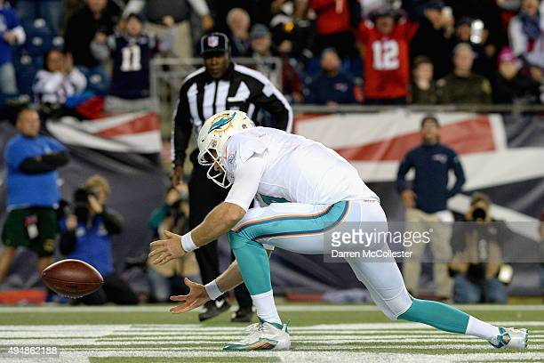 Ryan Tannehill of the Miami Dolphins mishandles a snap that leads to a safety during the second quarter against the New England Patriots at Gillette...