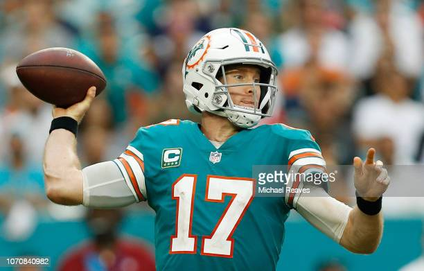 Ryan Tannehill of the Miami Dolphins passes during the second half against the New England Patriots at Hard Rock Stadium on December 9 2018 in Miami...