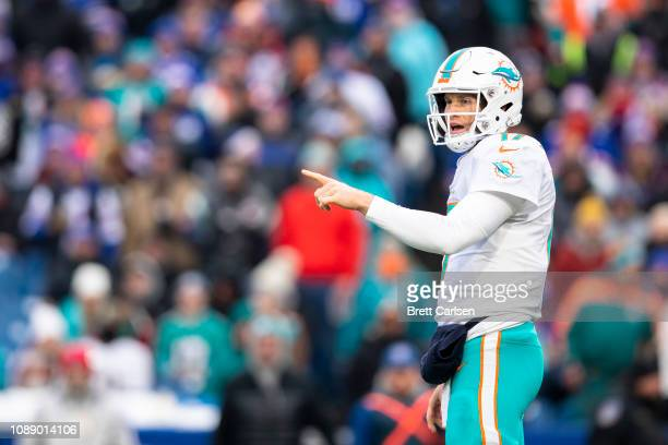 Ryan Tannehill of the Miami Dolphins points out defense during the first quarter against the Buffalo Bills at New Era Field on December 30 2018 in...