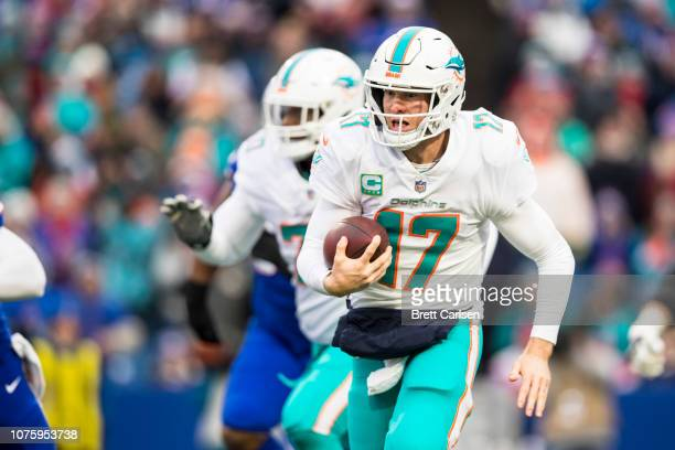 Ryan Tannehill of the Miami Dolphins runs with the ball during the first quarter against the Buffalo Bills at New Era Field on December 30 2018 in...