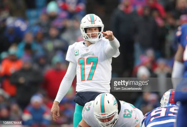 Ryan Tannehill of the Miami Dolphins signals in the second quarter during NFL game action against the Buffalo Bills at New Era Field on December 30...