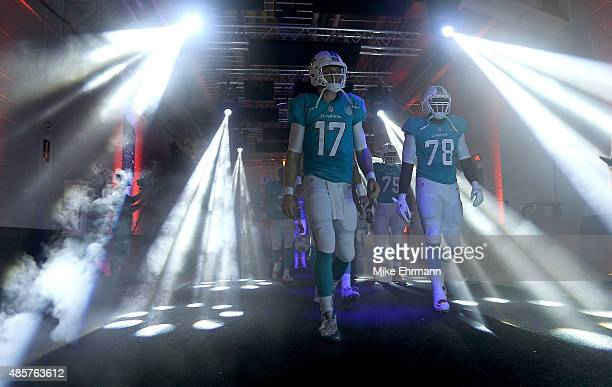 Ryan Tannehill of the Miami Dolphins takes the field during a preseason game against the Atlanta Falcons at Sun Life Stadium on August 29 2015 in...