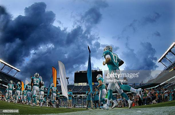 Ryan Tannehill of the Miami Dolphins takes the field during a preseason game against the Tampa Bay Buccaneers at Sun Life Stadium on September 3 2015...