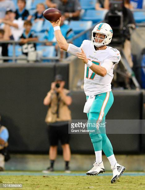 Ryan Tannehill of the Miami Dolphins throws a pass against the Carolina Panthers in the second quarter during the game at Bank of America Stadium on...