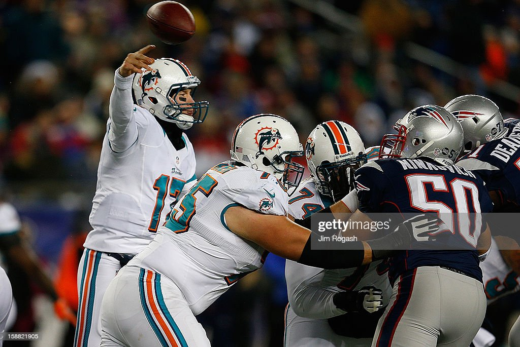 Ryan Tannehill #17 of the Miami Dolphins throws against the New England Patriots in the second half at Gillette Stadium on December 30, 2012 in Foxboro, Massachusetts.