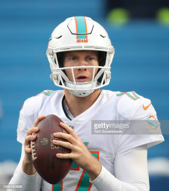 Ryan Tannehill of the Miami Dolphins warms up before the start of NFL game action against the Buffalo Bills at New Era Field on December 30 2018 in...