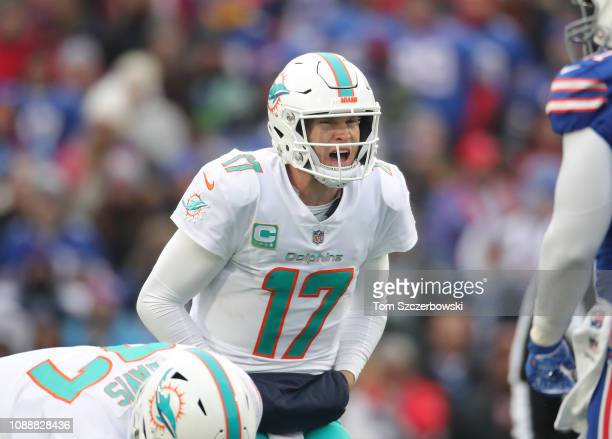 Ryan Tannehill of the Miami Dolphins yells out instructions prior to the snap in the first quarter during NFL game action against the Buffalo Bills...