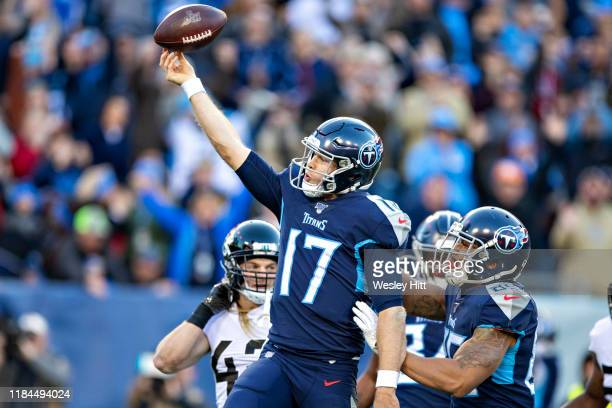 Ryan Tannehill of the Tennessee Titans celebrates after running the ball in for a touchdown in the first half of a game against the Jacksonville...