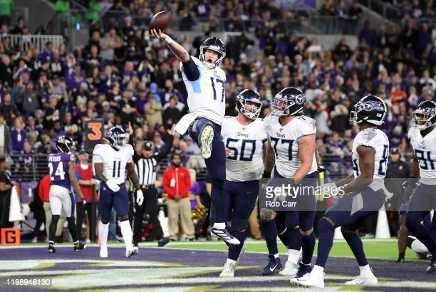Ryan Tannehill of the Tennessee Titans celebrates after rushing for a 1-yard touchdown during the third quarter against the Baltimore Ravens in the...