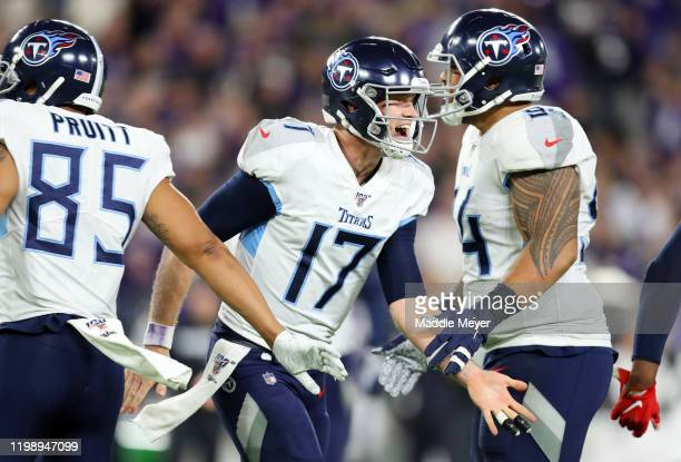 Ryan Tannehill of the Tennessee Titans celebrates after rushing for a 1yard touchdown during the third quarter against the Baltimore Ravens in the...