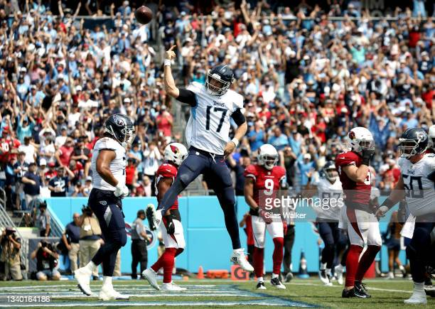 Ryan Tannehill of the Tennessee Titans celebrates scoring a touchdown during the second quarter against the Arizona Cardinals at Nissan Stadium on...