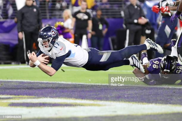 Ryan Tannehill of the Tennessee Titans dives for a 1yard rushing touchdown during the third quarter against the Baltimore Ravens in the AFC...