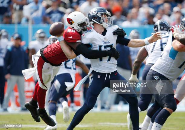 Ryan Tannehill of the Tennessee Titans fumbles after being hit by Chandler Jones of the Arizona Cardinals during the third quarter at Nissan Stadium...