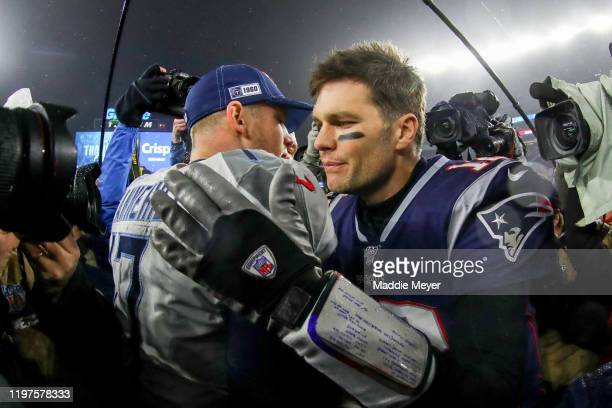 Ryan Tannehill of the Tennessee Titans is congratulated by Tom Brady of the New England Patriots after their 2013 win in the AFC Wild Card Playoff...