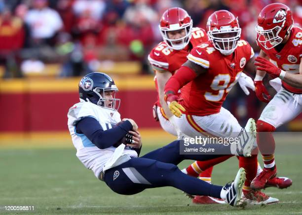 Ryan Tannehill of the Tennessee Titans is tackled after scrambling against Terrell Suggs and Daniel Sorensen of the Kansas City Chiefs in the AFC...