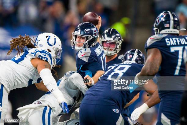 Ryan Tannehill of the Tennessee Titans looks for a receiver as he is sacked by Anthony Walker of the Indianapolis Colts during the second quarter at...