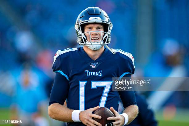 Ryan Tannehill of the Tennessee Titans smiles on the field during warm ups before a game against the Jacksonville Jaguars at Nissan Stadium on...