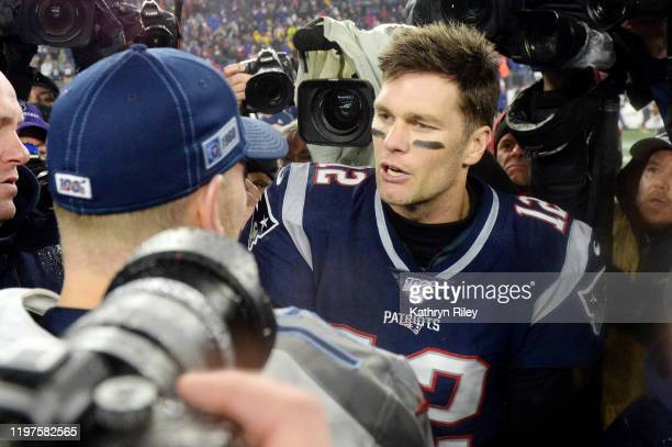 Ryan Tannehill of the Tennessee Titans talks with Tom Brady of the New England Patriots after the Titans 2013 win over the New England Patriots in...