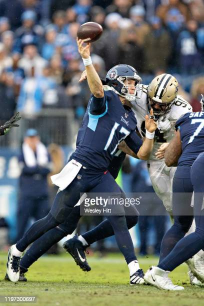 Ryan Tannehill of the Tennessee Titans throws a pass under pressure from Trey Hendrickson of the New Orleans Saints at Nissan Stadium on December 22...