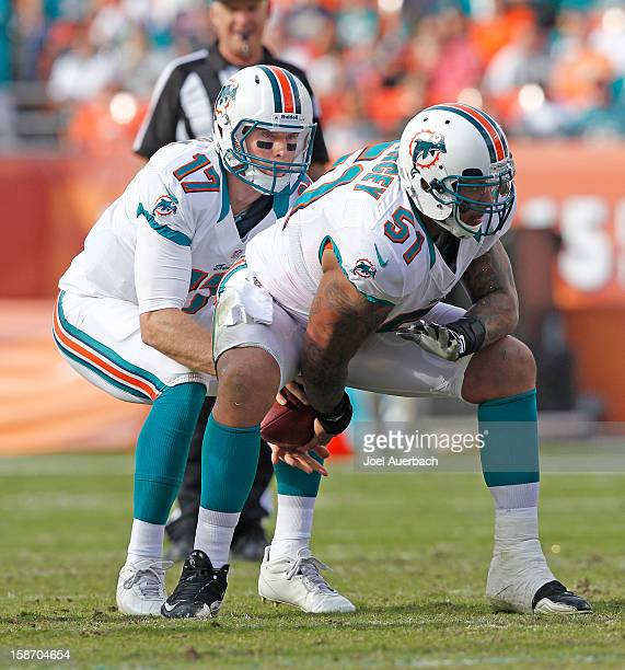 Ryan Tannehill takes a snap from Mike Pouncey of the Miami Dolphins against the Buffalo Bills on December 23 2012 at Sun Life Stadium in Miami...
