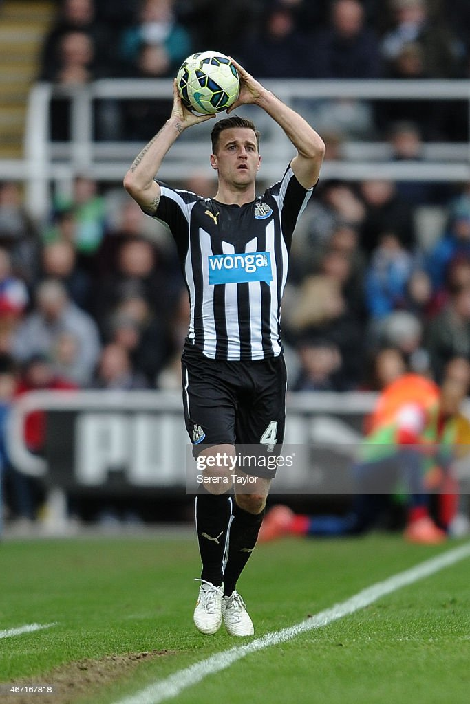 Ryan Taylor of Newcastle holds the ball above his head to throw into play during the Barclays Premier League match between Newcastle United and Arsenal at St.James' Park on March 21, 2015, in Newcastle upon Tyne, England.