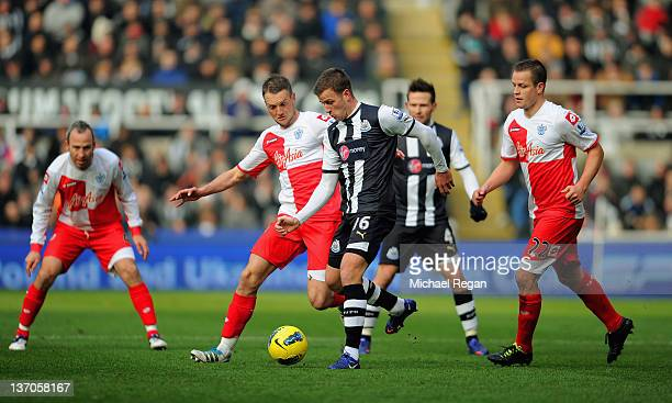 Ryan Taylor of Newcastle in action with Clint Hill and Heider Helguson of QPR during the Barclays Premier League match between Newcastle United and...