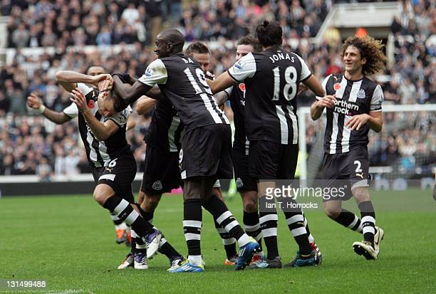 Ryan Taylor of Newcastle United celebrates with teammates after he scored the second goal during the Barclays Premier League match between Newcastle...