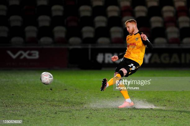 Ryan Taylor of Newport County scores his penalty during the FA Cup Third Round match between Newport County and Brighton And Hove Albion at Rodney...