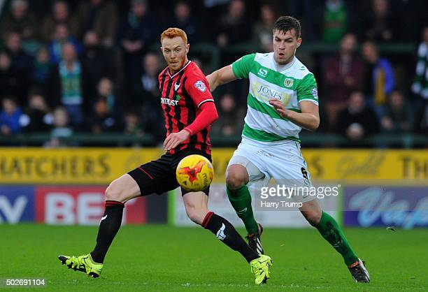 Ryan Taylor of Oxford United is tackled by Jakub Sokalik of Yeovil Town during the Sky Bet League Two match between Yeovil Town and Oxford United at...